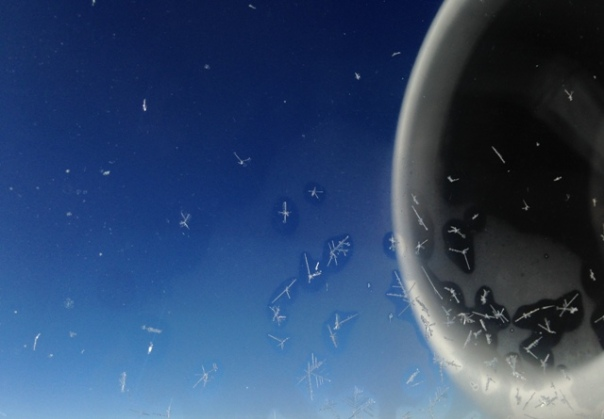 3 - airplane window ice crystals
