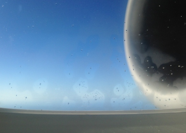5 - airplane window melted crystal droplets